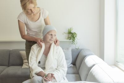 adult woman taking care of senior woman