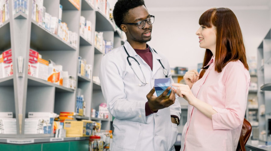pharmacist talking with a client in pharmacy